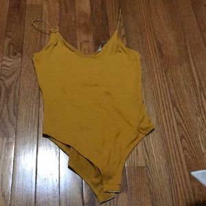 Mustard body suit, new never worn